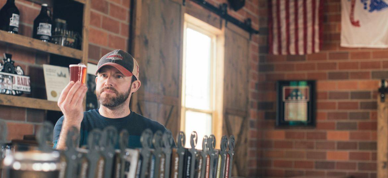Man looking at beer sample