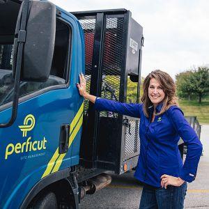 Perficut team member standing next to truck