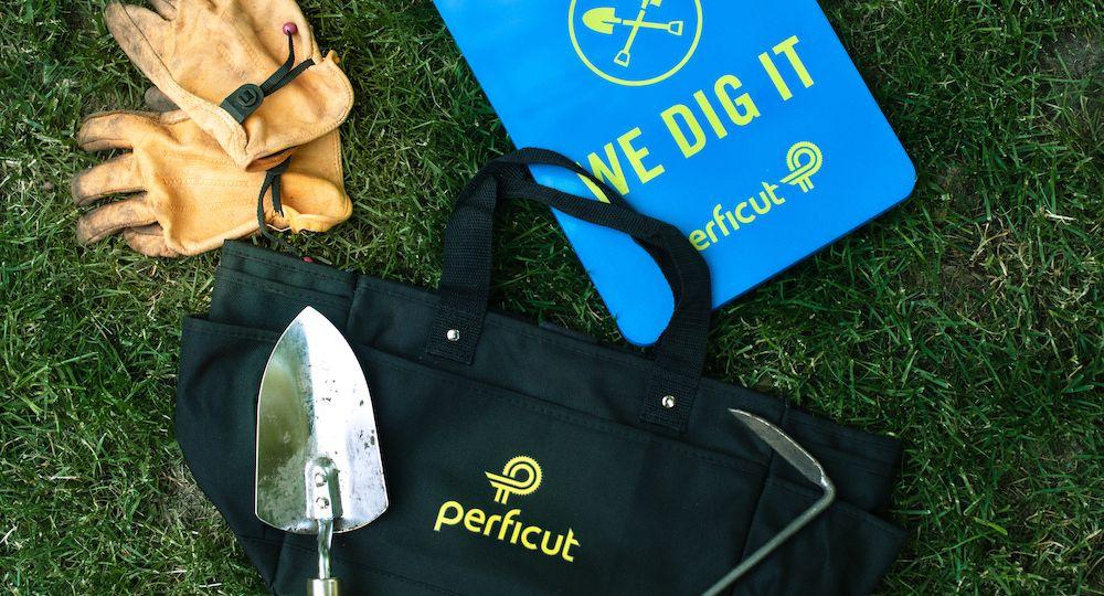 Gardening tools alongside black bag with Perficut logo and branded blue knee pad