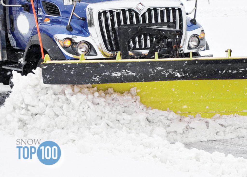 Snow plow plowing street