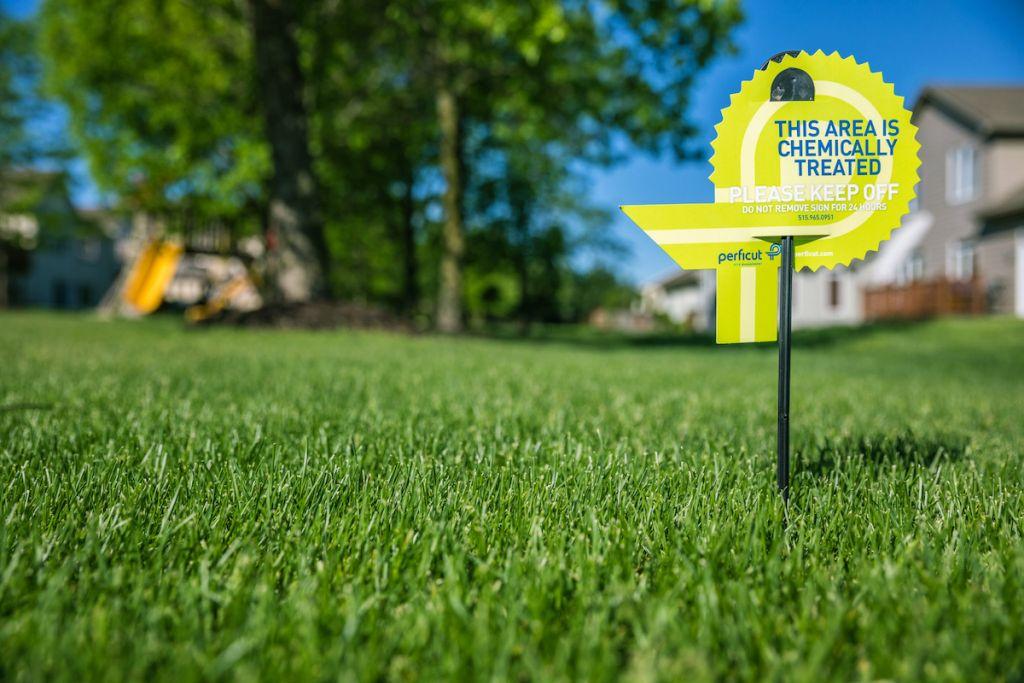 Perficut lawn treatment sign stuck in grass