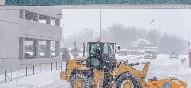 Perficut tractor removing snow